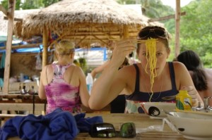 Trying a really spicy noodles on the beaches of Thailand
