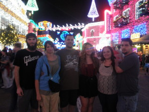 Under the Spectacle of Lights, Disney World Hollywood Studios, Nov 2014. L to R: my son Nick, Jean, me, daughters Alissa and Stefani, and her boyfriend Devin.