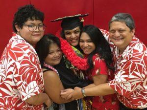 Emma and family at graduation