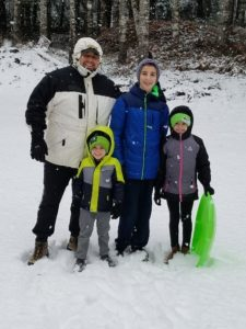 Family posing in the snow