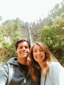 Kari with her husband in front of a waterfall