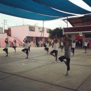 Daniela doing yoga with a local high school class in Peru
