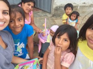 Daniela with children and mothers in Peru