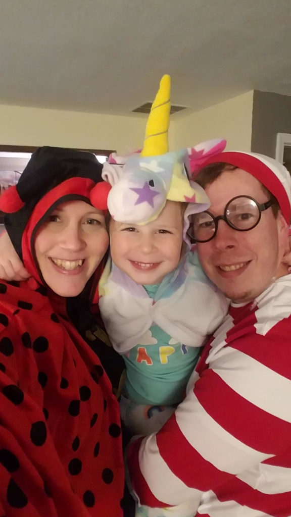 Amy, her husband and daughter in Halloween costumes